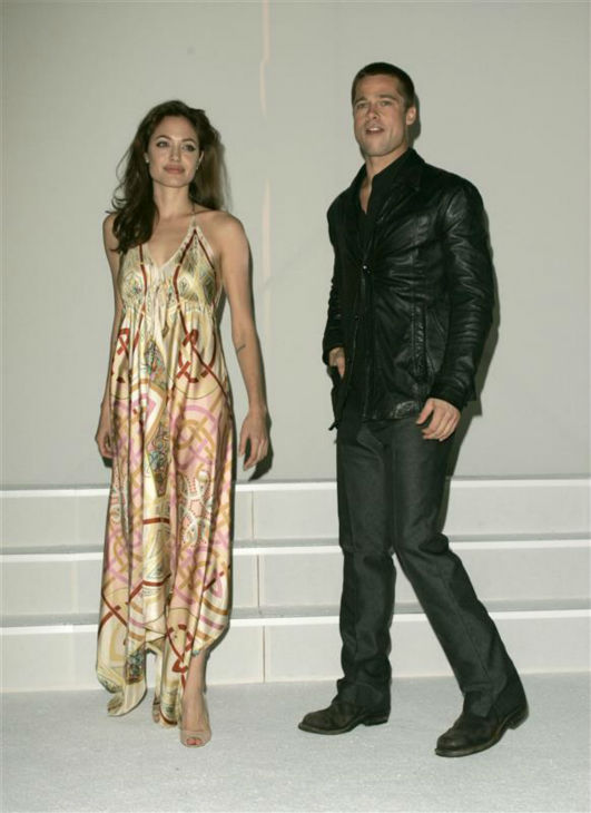Angelina Jolie and Brad Pitt appear at a Fox luncheon in Las Vegas on March 17, 2005. The two met on the set of the 2005 movie &#39;Mr. and Mrs. Smith&#39; and share six children. <span class=meta>(Shelly Patch &#47; Startraksphoto.com)</span>