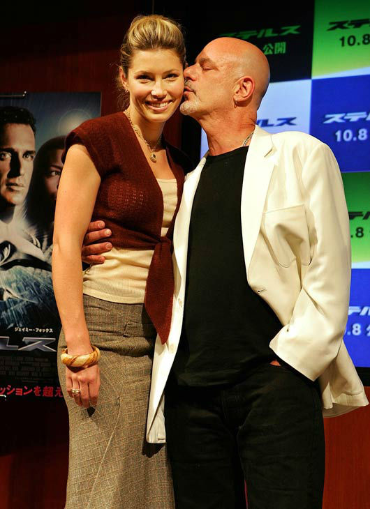 U.S. actress Jessica Biel, left, gets a kiss from director Rob Cohen at a press conference, promoting new film 'Stealth' at a hotel in Tokyo, Wednesday, Sept. 14, 2005. Cohen's new film with Biel playing her role as a naval aviator, will be released in Ja
