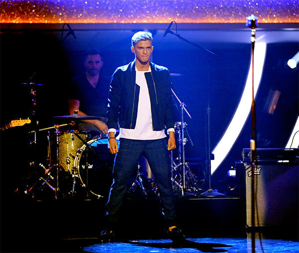Season 18 contestant Cody Simpson performs his single &#39;Surfboard&#39; during the season 18 finale of &#39;Dancing With the Stars&#39; on May 20, 2014. <span class=meta>(ABC Photo)</span>