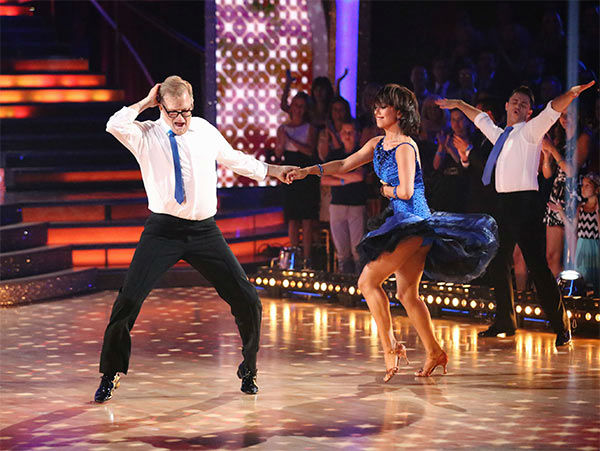 "<div class=""meta image-caption""><div class=""origin-logo origin-image ""><span></span></div><span class=""caption-text"">Drew Carey and his pro partner Cheryl Burke danced to 'You Can't Sit Down' during the season 18 finale of 'Dancing With The Stars' on May 20, 2014. (ABC Photo)</span></div>"
