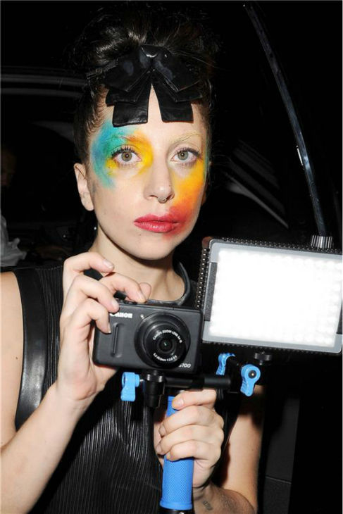 Lady Gaga tapes her fans at Micky&#39;s, a gay bar and nightclub in West Hollywood, California, on Aug. 12, 2013, the day she released her new single &#39;Applause&#39; following a leak she blamed on hackers. She sports similar makeup on the single&#39;s cover. <span class=meta>(Daniel Robertson &#47; startraksphoto.com)</span>