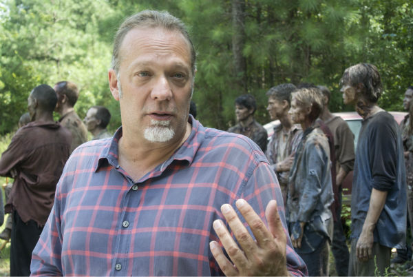 "<div class=""meta image-caption""><div class=""origin-logo origin-image ""><span></span></div><span class=""caption-text"">Co-Executive Producer/SFX Makeup Supervisor Greg Nicotero and actors dressed as Walkers appear on the set of AMC's 'The Walking Dead's season 4 midseason premiere, titled 'After,' which aired on Feb. 9, 2014. (Gene Page / AMC)</span></div>"
