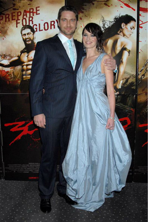 Lena Headey appears with Gerard Butler at the premiere of the movie &#39;300&#39; in London on March 15, 2007.  <span class=meta>(Richard Young &#47; Startraksphoto.com)</span>