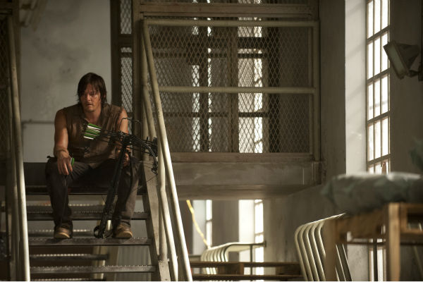 "<div class=""meta image-caption""><div class=""origin-logo origin-image ""><span></span></div><span class=""caption-text"">Norman Reedus (Daryl Dixon) chills out on the set of AMC's 'The Walking Dead' while filming episode 2 of season 4, titled 'Infected,' which aired on Oct. 20, 2013. (Gene Page / AMC)</span></div>"