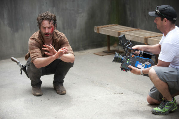 "<div class=""meta image-caption""><div class=""origin-logo origin-image ""><span></span></div><span class=""caption-text"">Andrew Lincoln (Rick Grimes) appears on the set of AMC's 'The Walking Dead's while filming episode 1 of season 4, titled '30 Days Without an Accident,' which aired on Oct. 13, 2013. (Gene Page / AMC)</span></div>"