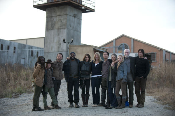 The cast of AMC's 'The Walking Dead' appears on the set of season 4. The finale aired on March 30, 2014.