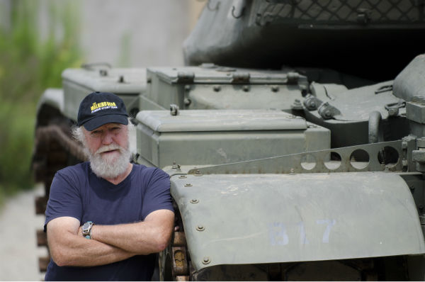 "<div class=""meta image-caption""><div class=""origin-logo origin-image ""><span></span></div><span class=""caption-text"">Scott Wilson (Hershel Greene) appears next to the Governor's tank on the set of AMC's 'The Walking Dead's season 4 midseason finale, which aired on Dec. 1, 2013. (Gene Page / AMC)</span></div>"