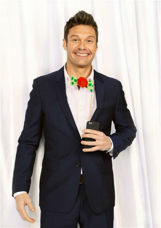 Ryan Seacrest poses in a holiday-themed photo booth at Z100&#39;s Jingle Ball 2013 on Dec. 13, 2013, just before Christmas. <span class=meta>(Sara Jaye Weiss  &#47; Startraksphoto.com)</span>