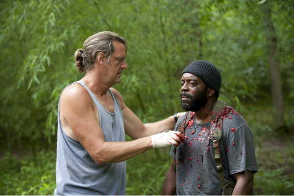 "<div class=""meta image-caption""><div class=""origin-logo origin-image ""><span></span></div><span class=""caption-text"">Special Effects Makeup Artist Jake Garber and Chad Coleman (Tyreese) appear on the set of AMC's 'The Walking Dead' while filming episode 3 of season 4, titled 'Isolation,' which aired on Oct. 27, 2013. (Gene Page / AMC)</span></div>"