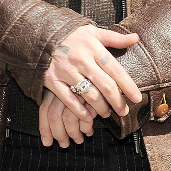 "<div class=""meta ""><span class=""caption-text "">Johnny Depp, wearing a brown jacket and the engagement ring he initially gave fiancee Amber Heard -- a 'chick's ring' -- arrives to a taping of 'The Late Show with David Letterman' in New York on April 3, 2014. (Bill Davila / Startraksphoto.com)</span></div>"