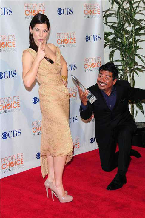 Sandra Bullock jokes with George Lopez at the 2010 People's Choice Awards in Los Angeles, California on Jan. 6, 2010.