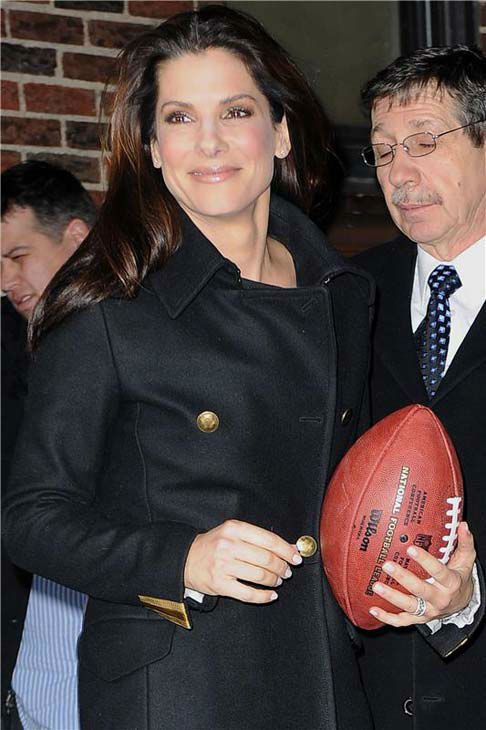 Sandra Bullock appears at 'The Late Show with David Letterman' carrying a football in New York City on Feb. 8, 2010.