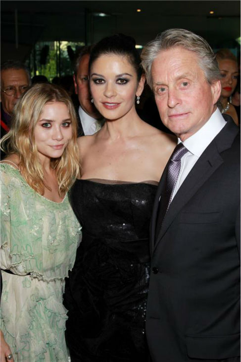 "<div class=""meta ""><span class=""caption-text "">Catherine Zeta-Jones and Michael Douglas pose with Ashley Olsen (left) at the 37th annual Chaplin Award Gala honoring Douglas in New York on May 24, 2010. (Marion Curtis /)</span></div>"
