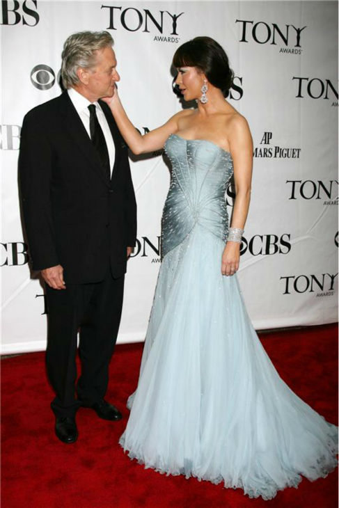 Michael Douglas and Catherine Zeta-Jones walk the red carpet at the 64th annual Tony Awards in New York on June 13, 2010. The actress won a Tony for