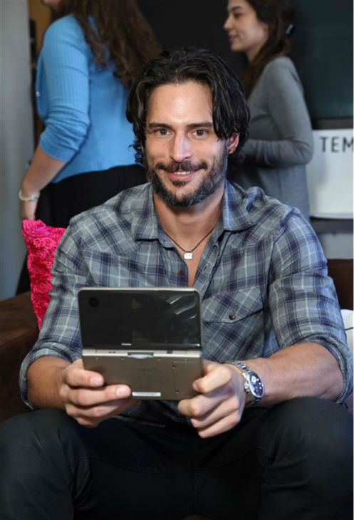 The &#39;I-Just-Learned-The-Princess-Is-In-Another-Castle&#39; stare: Joe Manganiello plays a Nintendo DSi at the company&#39;s studio at the Empire hotel in Loncoln Center during New York Fashion Week on Sept. 15, 2010. <span class=meta>(Sara Jaye Weiss &#47; Startraksphoto.com)</span>