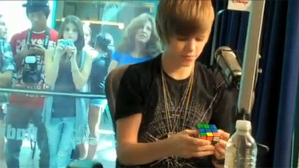 Bieber can solve a Rubik's cube in under a minute.