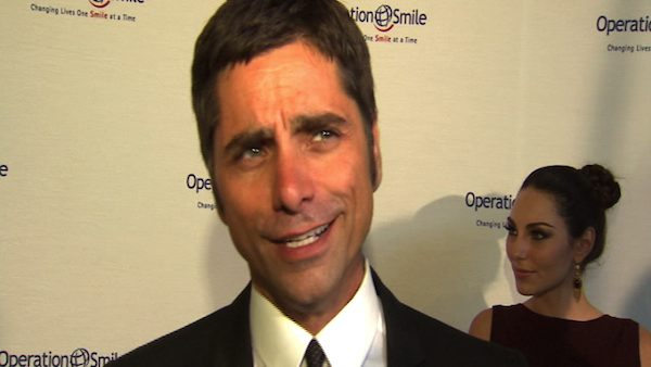 John Stamos speaks to OnTheRedCarpet.com in Los Angeles in September 2010.