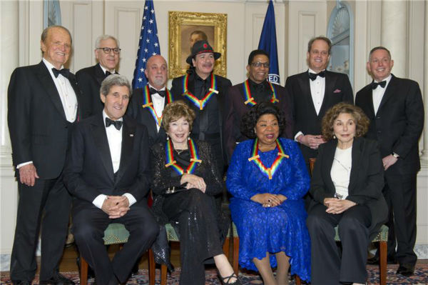 "<div class=""meta image-caption""><div class=""origin-logo origin-image ""><span></span></div><span class=""caption-text"">The 2013 Kennedy Center honorees -- opera singer Martina Arroyo; pianist,  keyboardist, bandleader and composer Herbie Hancock; pianist, singer and songwriter Billy Joel; actress Shirley MacLaine; and musician and songwriter Carlos Santana -- attend a gala in their honor, hosted by Secretary of State John F. Kerry in Washington, D.C., on Dec. 8, 2013. (Ron Sachs / Startraksphoto.com)</span></div>"