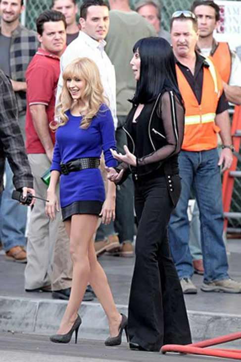 Cher and Christina Aguilera on the set of...