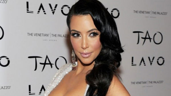 Kim Kardashian poses at Tao nighclub at the...