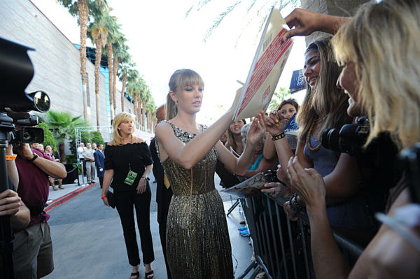 Taylor Swift greets fans at the 48th annual Academy of Country Music &#40;ACM&#41; Awards. The ceremony was co-hosted by Luke Bryan and Blake Shelton and was broadcast live from the MGM Grand Garden Arena in Las Vegas on CBS on Sunday, April 7, 2013. <span class=meta>(Heather Wines &#47; CBS)</span>