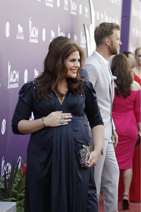 "<div class=""meta image-caption""><div class=""origin-logo origin-image ""><span></span></div><span class=""caption-text"">Hillary Scott of Lady Antebellum appears on the red carpet at the 48th annual Academy of Country Music (ACM) Awards. The ceremony was co-hosted by Luke Bryan and Blake Shelton and was broadcast live from the MGM Grand Garden Arena in Las Vegas on CBS on Sunday, April 7, 2013. (Francis Specker / CBS)</span></div>"
