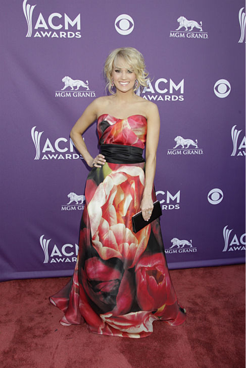 "<div class=""meta image-caption""><div class=""origin-logo origin-image ""><span></span></div><span class=""caption-text"">Carrie Underwood appears on the red carpet at the 48th annual Academy of Country Music (ACM) Awards. The ceremony was co-hosted by Luke Bryan and Blake Shelton and was broadcast live from the MGM Grand Garden Arena in Las Vegas on CBS on Sunday, April 7, 2013. (Francis Specker / CBS)</span></div>"