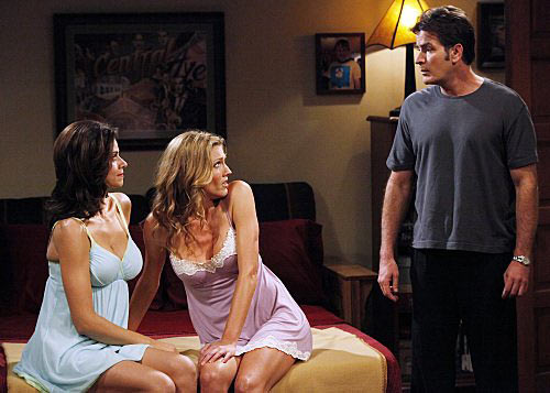 Still of Charlie Sheen, Jennifer Taylor and Tricia Helfer in their CBS comedy, 'Two and a Half Men.'