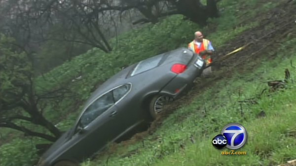 Photo of Charlie Sheen's Mercedes-Benz being pulled out of a ravine, as covered by ABC7.