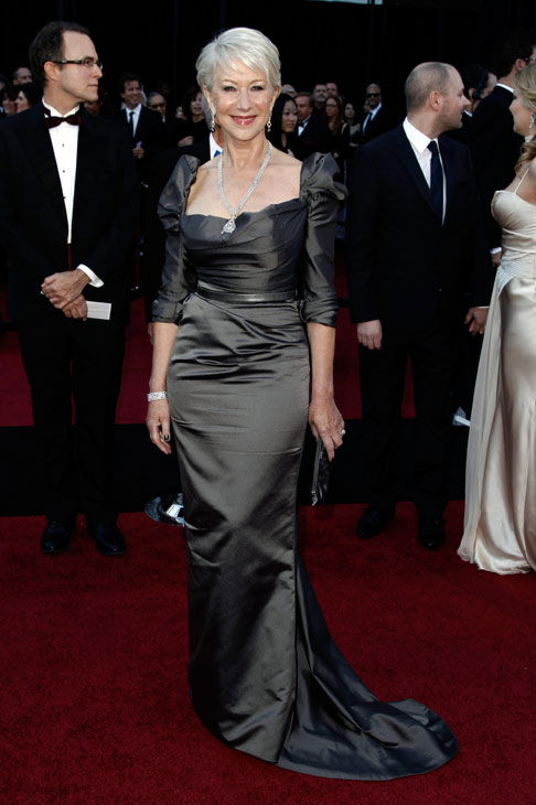 Oscar-winning actress Helen Mirren arrives before the 83rd Academy Awards on Sunday, Feb. 27, 2011, in the Hollywood section of Los Angeles. She is wearing Cartier jewelry and a silky grey Vivienne Westwood gown, which features capped sleeves. <span class=meta>(AP Photo&#47;Matt Sayles)</span>