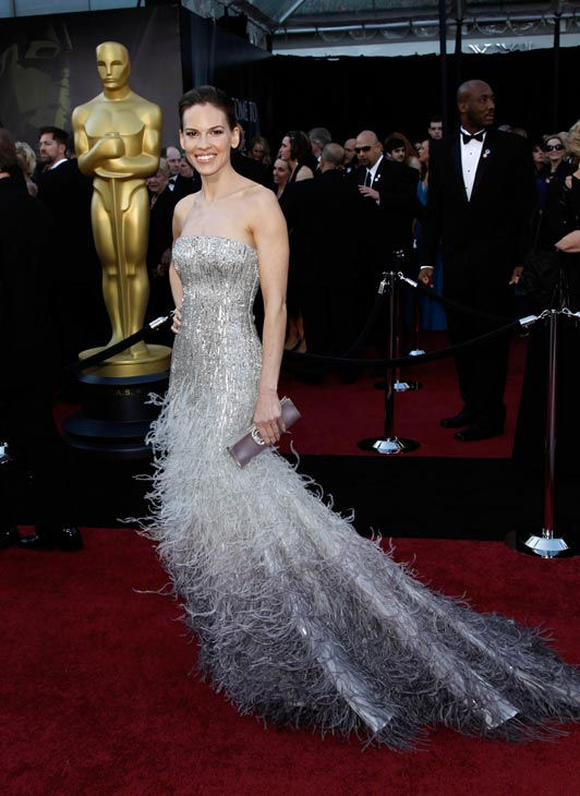 Oscar-winning actress Hilary Swank arrives before the 83rd Academy Awards on Sunday, Feb. 27, 2011, in the Hollywood section of Los Angeles. She is wearing a silver Colleen Atwood dress that features a lot of furry detail along the bottom.