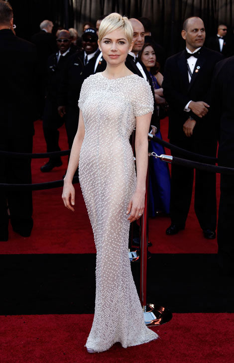 Actress Michelle Williams arrives before the 83rd Academy Awards on Sunday, Feb. 27, 2011, in the Hollywood section of Los Angeles. She is wearing a floor length Chanel gown with detail from top to bottom. <span class=meta>(AP Photo&#47;Matt Sayles)</span>