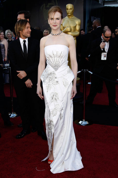 "<div class=""meta ""><span class=""caption-text "">Actress Nicole Kidman, who is nominated for a 'Best Actress' Oscar for her role in 'Rabbit Hole' arrives before the 83rd Academy Awards on Sunday, Feb. 27, 2011, in the Hollywood section of Los Angeles.  She is wearing a white floor length Dior gown with silver detail and a small front slit that shows off her red Pierre Hardy shoes.  (AP Photo/Matt Sayles)</span></div>"