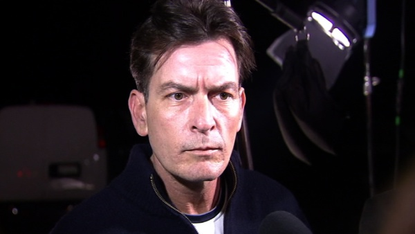 Charlie Sheen talks to reporters after the...