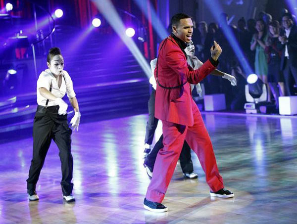 Chris Brown stopped by to perform his hit single 'Forever' and his newest hit 'Yeah 3X,' from his new album, 'F.A.M.E.,' on 'Dancing With The Stars: The Results Show,' Tuesday, Ma