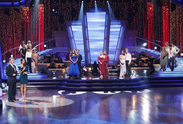 The cast of 'Dancing With The Stars' await possible elimination. (Pictured: TOM BERGERON, BROOKE BURKE, WENDY WILLIAMS, TONY DOVOLANI, KENDRA WILKINSON, LOUIS VAN AMSTEL, CHERYL BURKE and CHRIS JERICHO)