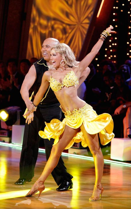 Hines Ward and his partner Kym Johnson perform...