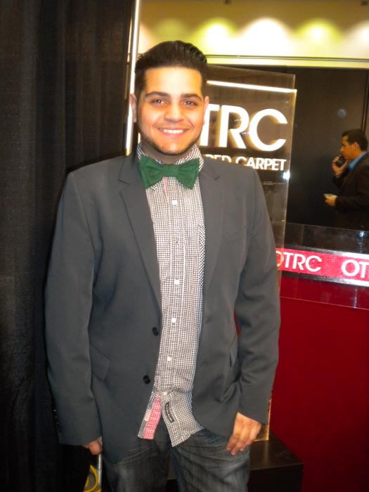 "<div class=""meta ""><span class=""caption-text "">Michael Costello from 'Project Runway' season 8 talks to 'On The Red Carpet' at the Reality Rocks Expo at the Los Angeles Convention Center on April 9, 2011. (OTRC)</span></div>"