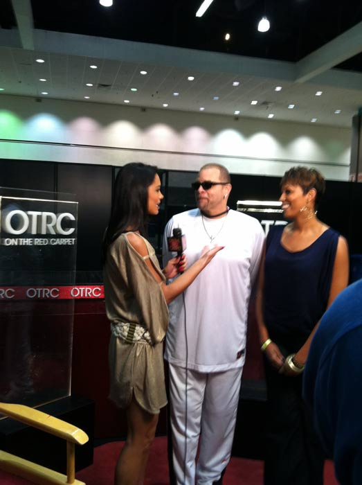 Comedian Sinbad and his daughter stop by to chat with 'On The Red Carpet' host Rachel Smith about his new reality show 'Sinbad's Family Affair' at the Reality Rocks Expo at the Los Angeles Convention Center on April 9, 2011.