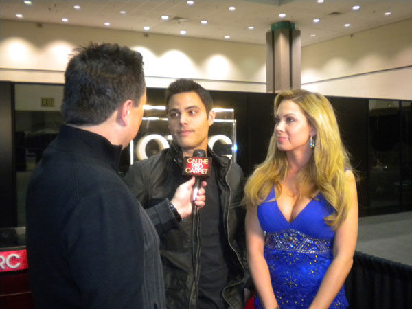 'True Beauty' stars David Palmer and Erika Othen chat with KABC Television's George Pennacchio at the Reality Rocks Expo at the Los Angeles Convention Center on April 10, 2011.