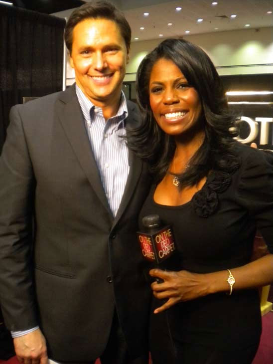 "<div class=""meta image-caption""><div class=""origin-logo origin-image ""><span></span></div><span class=""caption-text"">'The Apprentice' star Omarosa talks to 'On The Red Carpet'host Chris Balish at the Reality Rocks Expo at the Los Angeles Convention Center on April 10, 2011.  (OTRC Photo)</span></div>"