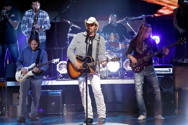 "<div class=""meta ""><span class=""caption-text "">Toby Keith ties for ninth place with $55 million, according to Forbes' List.  With his Ford sponsorship entering its second decade and his 'I Love This Bar And Grill' restaurant chain booming, Keith tops country earners for the second consecutive year. New album Clancy's Tavern helped him sell out shows across the country.  (Pictured: Special musical guest country star Toby Keith performed two of his biggest hits. In a tribute to U.S. Troops overseas he sang 'American Soldier' and was accompanied by 'Dancing With The Stars' pros Anna Trebunskaya and Jonathan Roberts on April 19, 2011. (ABC Photo/ Adam Taylor)</span></div>"