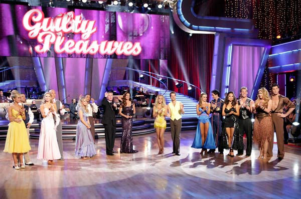 "<div class=""meta ""><span class=""caption-text "">'Dancing with the Stars' celebrated Guilty Pleasures Night as each of the seven remaining couples competed -- with either a latin or ballroom style they had yet to perform -- set to the tunes of some of their favorite musical 'guilty pleasures.' Monday night's show also featured the first-ever Monday night performance by a live band when pop music sensations Hanson sang their fan favorite, 'MmmBop.' (Pictured: CHELSEA KANE, MARK BALLAS, KYM JOHNSON, HINES WARD, CHELSIE HIGHTOWER, ROMEO, TOM BERGERON, BROOKE BURKE, KENDRA WILKINSON, LOUIS VAN AMSTEL, KARINA SMIRNOFF, RALPH MACCHIO, CHERYL BURKE, CHRIS JERICHO, KIRSTIE ALLEY and MAKSIM CHMERKOVSKIY) (ABC Photo/ Adam Taylor)</span></div>"
