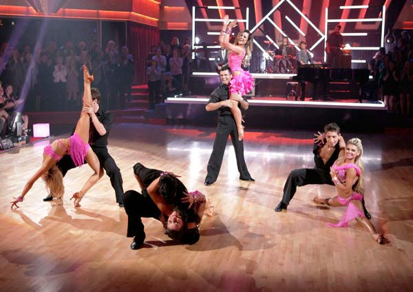 The band Hanson performed &#39;MmmBop&#39; during &#39;Guilty Pleasures&#39; night on &#39;Dancing With The Stars&#39; on April 25, 2011. &#40;Pictured: PETA MURGATROYD, TRISTAN MACMANUS, TED VOLYNETS, NICOLE VOLYNETS, TONY DOVOLANI, LACEY SCHWIMMER, KIKI NYEMCHEK and OKSANA DMYTRENKO&#41; <span class=meta>(ABC Photo&#47; Adam Taylor)</span>