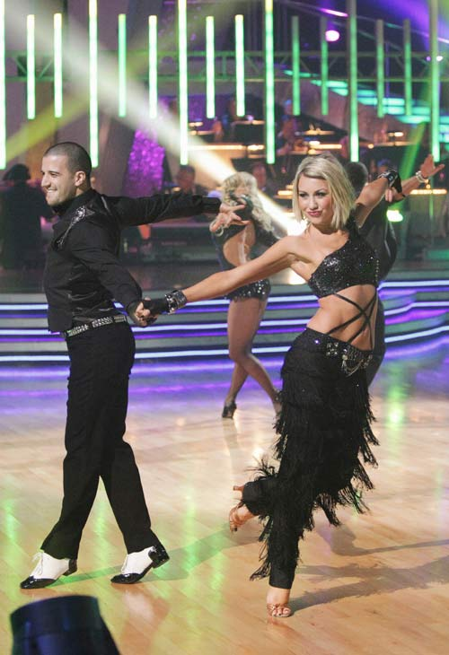 Chelsea Kane and her partner Mark Ballas do a very fun and very energetic Cha Cha to Lady Gaga's 'Born this Way' for the group dance.  Their team scores a 30 out of 40.