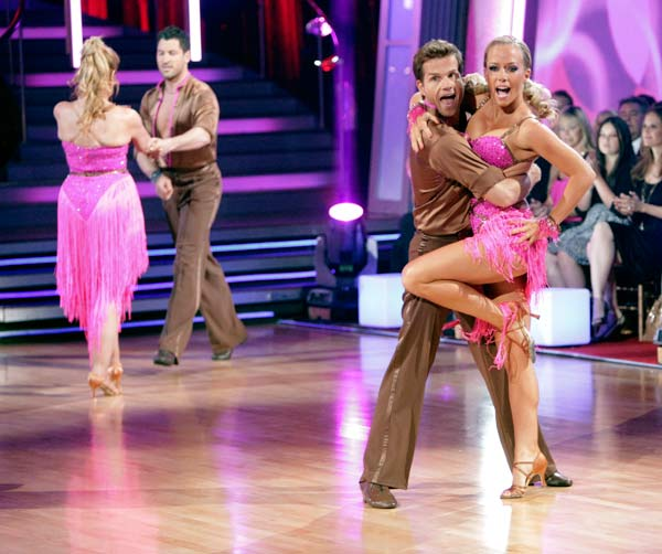 "<div class=""meta ""><span class=""caption-text "">Kendra Wilkinson and her partner Louis van Amstel shook all that they've got to Ke$ha's song 'We R Who We R' for the group dance.  Their team scores a 30 out of 40. (ABC Photo/ Adam Taylor)</span></div>"
