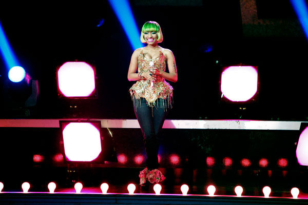 "<div class=""meta ""><span class=""caption-text "">Nicki Minaj performed 'Moment 4 Life' on the 'Dancing With The Stars' stage on Tuesday, May 03, 2011. Dancers Lacey Schwimmer, Chelsie Hightower, Kiki Nyemchek and Sonny Pederson performed an accompanying dance.  (ABC Photo/ Adam Taylor)</span></div>"