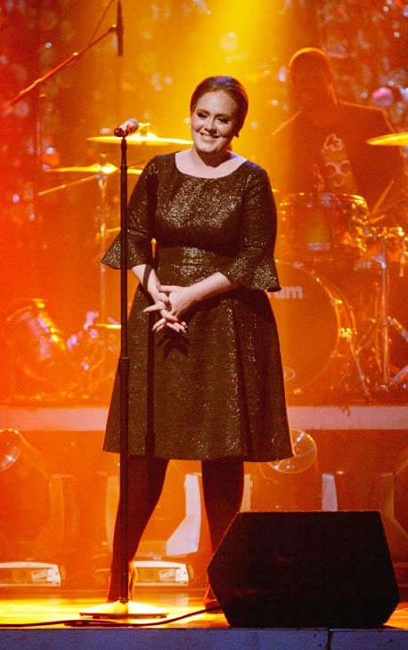 Adele takes the stage to sing her hit single...