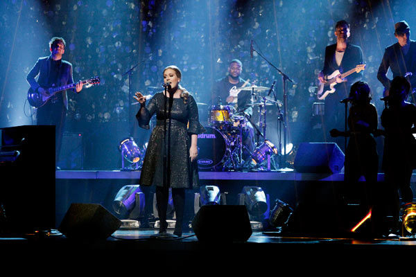 Grammy Award-winning artist Adele takes the stage to sing her hit single
