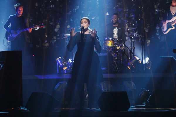 "<div class=""meta ""><span class=""caption-text "">Grammy Award-winning artist Adele takes the stage to sing her hit single ""Rolling in the Deep"" from her album ""21"" on week eight of 'Dancing With The Stars' on Tuesday, May 11, 2011.  (ABC Photo/ Adam Taylor)</span></div>"